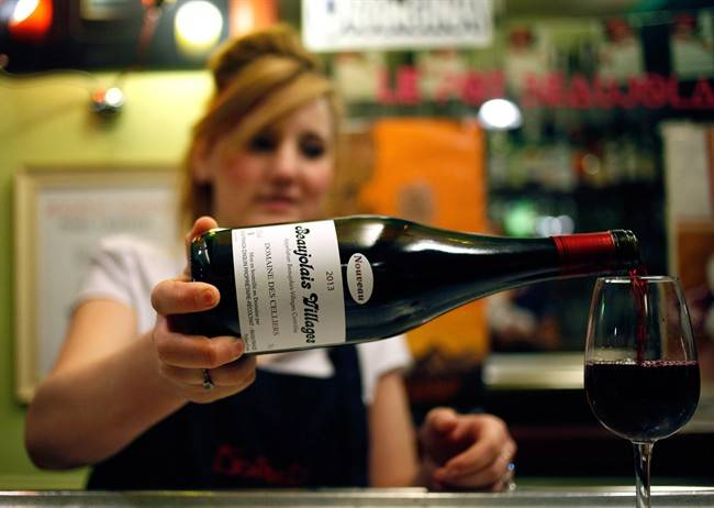 A liquor policy recommendation being considered by the B.C. government could make for a cheaper glass of wine at a bar or restaurant. THE CANADIAN PRESS/AP, Michel Spingler